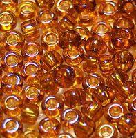 Бисер №11090, №10, Preciosa (Чехия), тёмно-янтарный, полупрозрачный, радужный