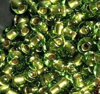 Бисер №55434, №10, Preciosa (Чехия), зеленый с бронзовой серединой, прозрачный